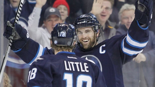 Winnipeg Jets' Bryan Little and Captain Andrew Ladd celebrate Little's second-period goal against the Phoenix Coyotes on Thursday.