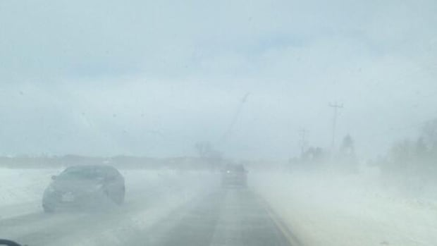 This photo was taken by CBC News reporter Shannon Martin from the dashboard of her vehicle as she approached Thursday's pileup south of Barrie, Ont. This image, which was not taken from the passenger seat, shows the kind of low visibility that snow squalls can create.