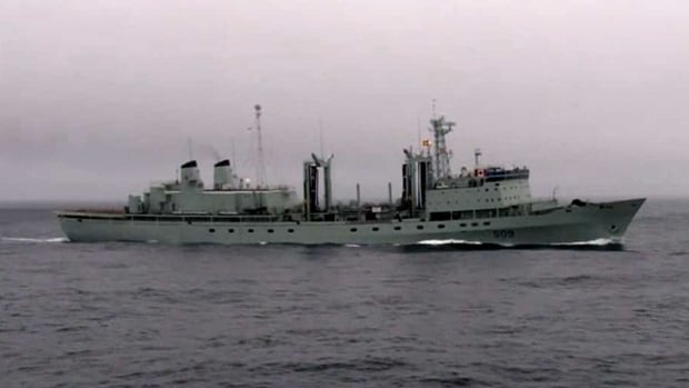 HMCS Protecteur is under tow to Pearl Harbor after an engine fire left it stranded in the mid-Pacific.