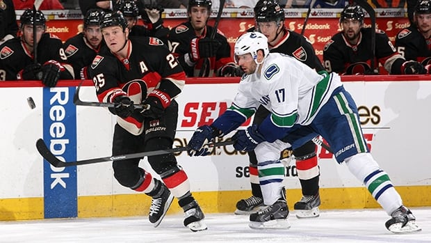 Chris Neil of the Ottawa Senators, left, and Ryan Kesler of the Vancouver Canucks at Canadian Tire Centre on November 28, 2013 in Ottawa.
