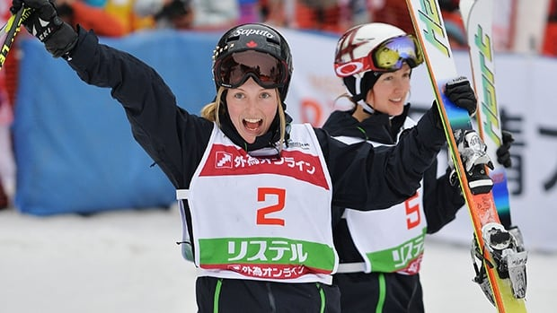 Gold medalist Justine Dufour-Lapointe celebrates after the super final during the 2014 FIS Free Style Ski World Cup at Listel Inawashiro on March 1, 2014 in Japan.