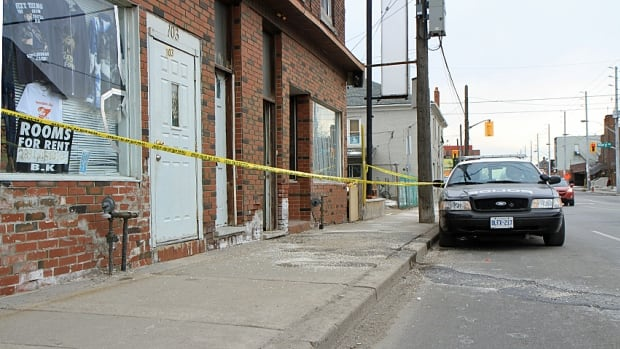 Police hold the scene of a fatal stabbing on Barton Street East near Mary Street in central Hamilton.