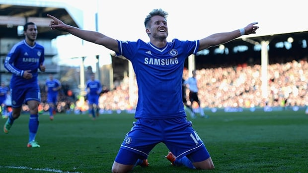 Andre Schurrle of Chelsea celebrates as he completes his hat trick against Fulham at Craven Cottage on March 1, 2014 in London, England.