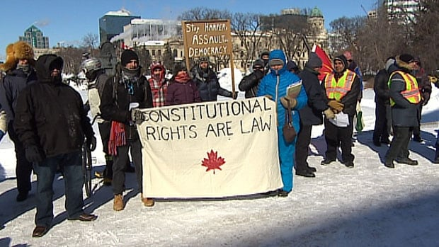 Protesters at the Manitoba Legislature Saturday said Prime Minister Stephen Harper's support for massive pipeline projects puts the environment and aboriginal rights at risk.