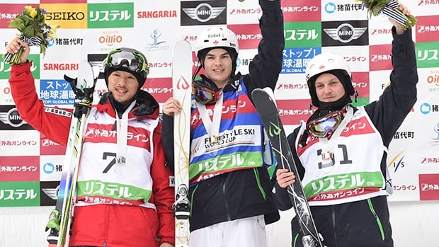 Left to right, Sho Endo of Japan, Mikael Kingsbury of Canada and Pascal-Olivier Gagne at Listel Inawashiro on March 2, 2014 in Inawashiro, Japan.