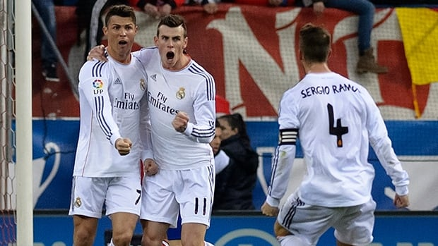 Real Madrid forward Cristiano Ronaldo, left, celebrates with teammates after scoring against Atletico at the Vicente Calderon stadium in Madrid on March 2, 2014.