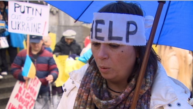 Members of Vancouver's Ukrainian community rallied at the Vancouver Art Gallery Sunday demanding the withdrawal of Russian troops and voicing concern for their families.