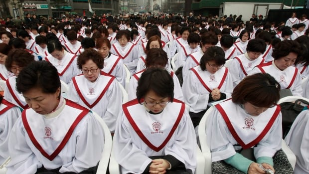 Christians pray during a rally denouncing North Korea Saturday in Seoul, South Korea.