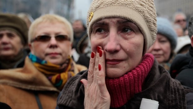 A woman reacts, during a rally in Kiev's Independence Square, Sunday, March 2, 2014.