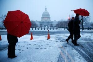 U.S. winter storm Washington Capital umbrellas