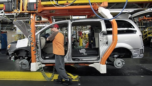A Chrysler employee works the line in the automaker's Windsor Assembly Plant, where the company will continue its operations.