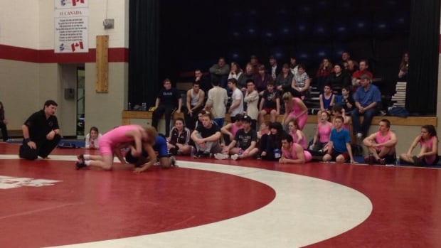 Wrestlers at the 2014 Newfoundland and Labrador Winter Games wear pink as they compete. They say it is a statement against bullying.