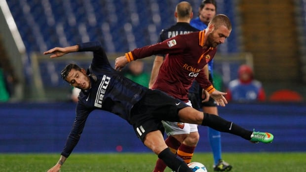AS Roma midfielder Daniele De Rossi, right, fouls Inter Milan midfielder Gabriel Alvarez during their match Saturday at Rome's Olympic stadium.