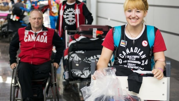 Alpine skier Alexandra Starker, right, leads a crew of Canadian arrivals on Monday in Sochi for the 2014 Paralympic Games. Canadian athletes will compete despite heightened conflict in nearby Ukraine, the Canadian Paralympic Committee says.