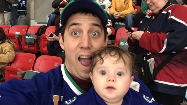 Jon Lampard with daughter Quinnlyn at Heritage Classic in Vancouver Sunday.  The NHL had a last minute change of heart after stories ran on CBC and Chek TV Saturday and found a free ticket for the six-month-old girl.