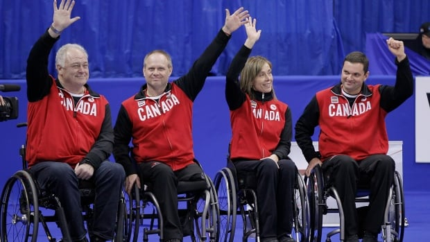 From left, skip Jim Armstrong, Dennis Thiessen, Sonja Gaudet, and Mark Ideson were introduced during the 2013 Roar of the Rings curling championship in Winnipeg on Dec. 6, 2013.