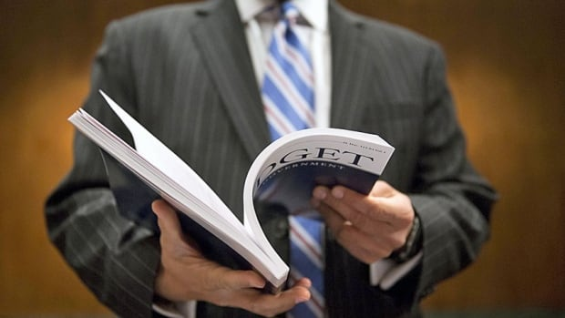 A Senate staffer holds a copy of Obama's budget Tuesday, the document that outline how the President wants to spend $4 trillion in taxpayer money this year.