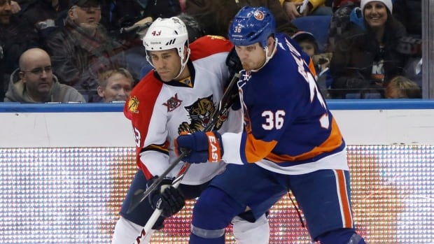 Defenceman Mike Weaver, left, has suited up for five NHL teams in his career, with Florida the most recent.