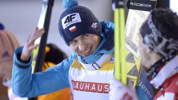 Poland's Kamil Stoch, centre, celebrates winning the large hill ski jumping FIS World Cup in Kuopio, Finland, Tuesday.