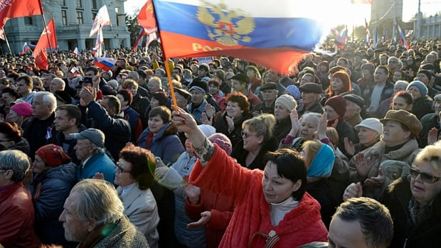 Pro-Russian demonstrators rally in the Crimean town of Yevpatoria on Wednesday as Russia rebuffed Western demands to withdraw forces in Ukraine's Crimea region to their bases.