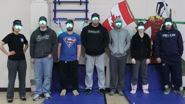 Military volunteers at the Canadian Forces Station in Alert, Nunavut, wear special visors for a study into sleep and Seasonal Affective Disorder.