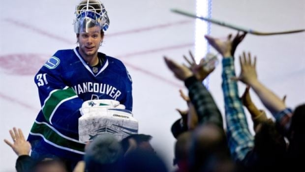 Eddie Lack smiles after his first NHL shutout in December 2013