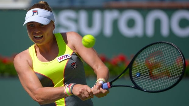 Vera Zvonareva returns a shot against Peng Shuai during a first-round match at the BNP Paribas Open on Wednesday in Indian Wells, Calif.