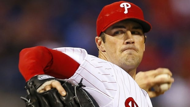 The Phillies have shut down pitcher Cole Hamels at spring training for at least a week to rest his tired arm. He arrived at camp behind schedule after dealing with biceps tendinitis that began in November.