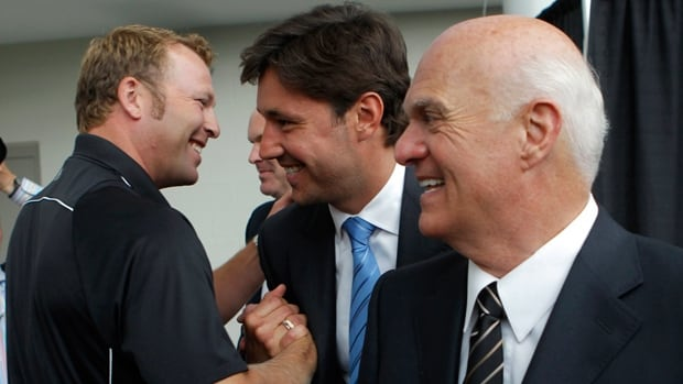 Devils goalie Martin Brodeur, left, embraces Ilya Kovalchuk, centre, as Devils president and General Manager Lou Lamoriello, right, smiles after a news conference announcing Kovalchuk signing a long-term contract on July 20, 2010. Three years later, Kovalchuk retired from the NHL.