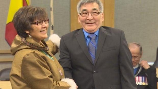 Rankin Inlet South MLA Alexander Sammurtok is sworn in by Nunavut commissioner Edna Elias on March 6, 2014.
