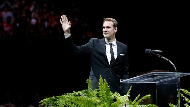 Former Detroit Red Wing Nicklas Lidstrom waves to the crowd during the retirement ceremony for his No. 5 before Thursday's game between the Detroit Red Wings and Colorado Avalanche.