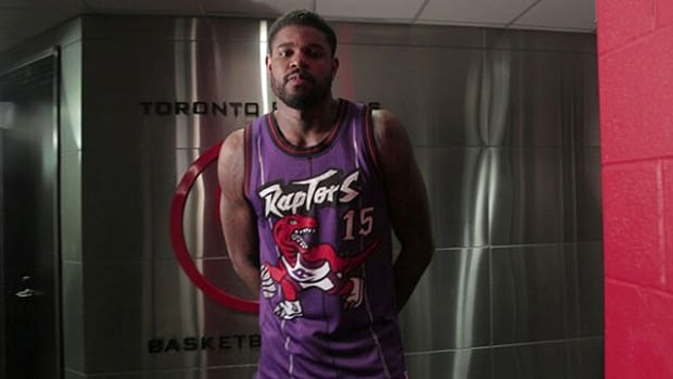 Toronto Raptors player Amir Johnson wearing the team's original purple jersey.
