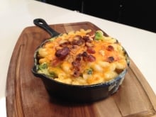 Mac & Cheese w Bothwell aged cheddar sauce with broccoli and bacon, baked with a crunchy pretzel top