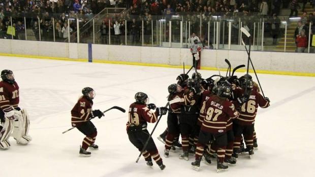 The Mount Allison University women's hockey team celebrates an overtime win Thursday against the Université de Moncton.