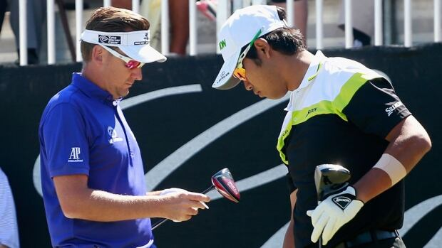 Hideki Matsuyama of Japan, right, and Ian Poulter of England wait on the first tee during the third round of the World Golf Championships-Cadillac Championship at Trump National Doral on Saturday in Doral, Fla. Poulter was upset that Matsuyama damaged a putting surface during the second round.