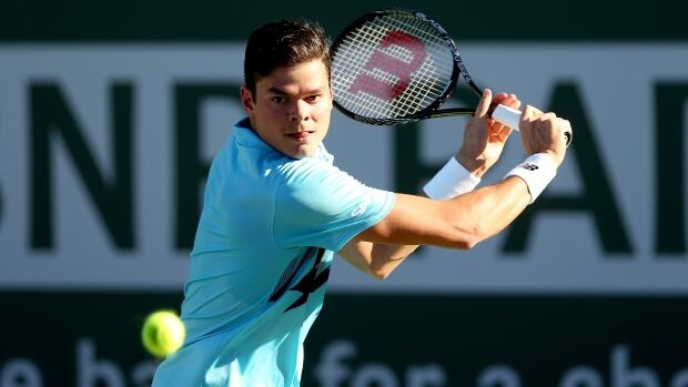 Milos Roanic of Canada returns a shot to Edouard Roger-Vasselin of France during the BNP Parabas Open at the Indian Wells Tennis Garden on Saturday.