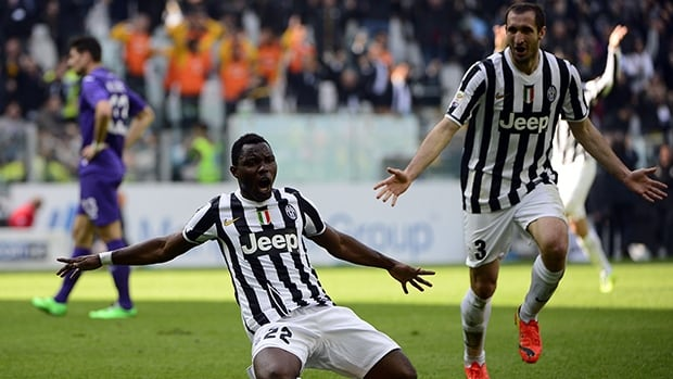 Juventus' Kwadwo Asamoah, left, celebrates after scoring against Fiorentina on March 9, 2014, at Alps stadium in Turin.