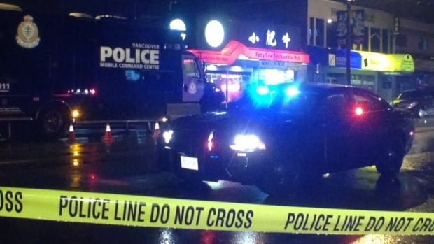 Police cordoned off the area around Victoria Drive and E 35th Avenue in Vancouver after a man with bullet wounds stumbled into a restaurant Saturday night.