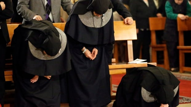 Lebanese nuns pray during a mass service for the Patriarch of Antioch and the East, Ignatius Hazim IV, not pictured, at the Saint Nicolas Church in Beirut, Lebanon, Thursday Dec. 6, 2012.
