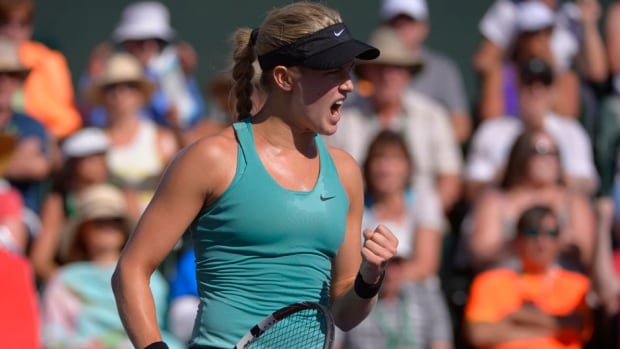 Eugenie Bouchard, of Canada, celebrates her 6-3, 6-3 win over Sara Errani, of Italy, in a match at the BNP Paribas Open on Sunday in Indian Wells, Calif.