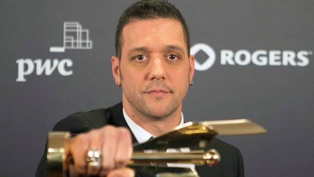 George Stroumboulopoulos, shown in this 2013 file photo, will end his CBC talk show this year as he moves to Rogers.