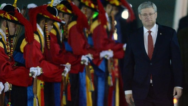 Prime Minister Stephen Harper arrives in Seoul, South Korea, on March 10 before the announcement of the free trade deal.