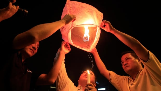 A candlelight vigil for passengers aboard a missing Malaysia Airlines plane was held in Kuala Lumpur on Monday. Families still don't know what happened to the missing flight.
