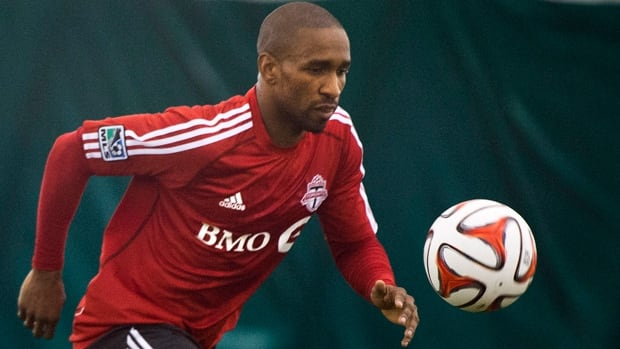 Toronto FC's Jermain Defoe takes part in a drill at practice in Toronto on Monday. The MLS club opens its season Saturday in Seattle.