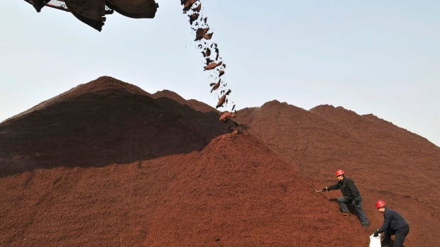 Prices of iron ore and shares of the mining companies that depend on the commodity took a tumble Monday on weak economic data out of China that exacerbated fears of a worsening slowdown.