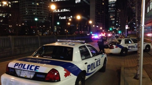 Police arrived at the scene in Coal Harbour minutes after the two men were shot.