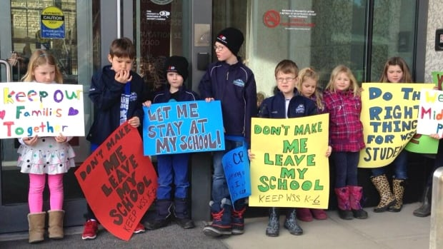 Students gathered in front of the Calgary Board of Education building in March to protest the changes to their school.