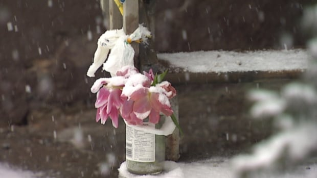 Flowers were left outside David Rose's home Tuesday.