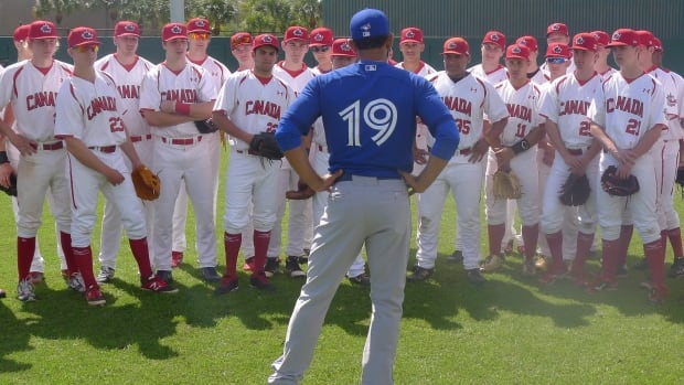Toronto Blue Jays rightfielder Jose Bautista talks with members of Canada's national junior baseball team at Al Lang Field in St. Petersburg, Fla. on Tuesday after the teams played a spring training game. The Jays split squad will play the national juniors later Tuesday.