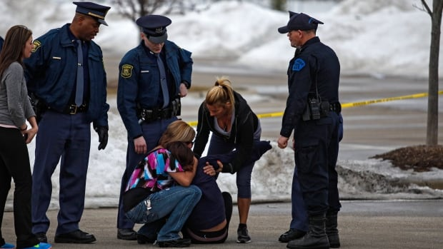 Skye Cieszlak, Terry Trafford's girlfriend, is comforted after collapsing in the parking lot of the Saginaw Township Wal-Mart, where police found his body Tuesday afternoon.